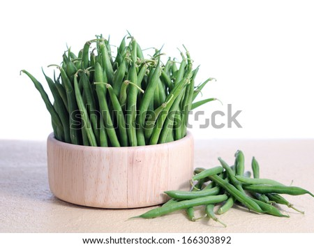 green beans in wooden bowl on white background  - stock photo