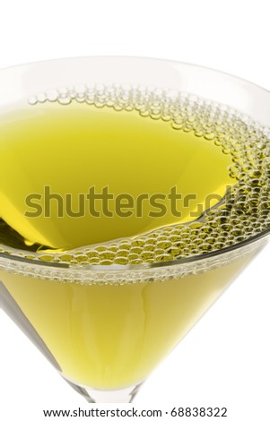 Green cocktail in martini glass - stock photo