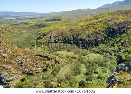 'Green river' - valley among awesome mountains. Shot in Salmonsdam Nature Reserve, near Hermanus/Stanford, Western Cape, South Africa. - stock photo