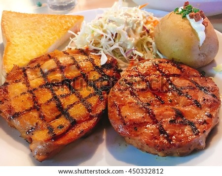 Grilled Steak pork spicy sauce with Bread and salad  - stock photo