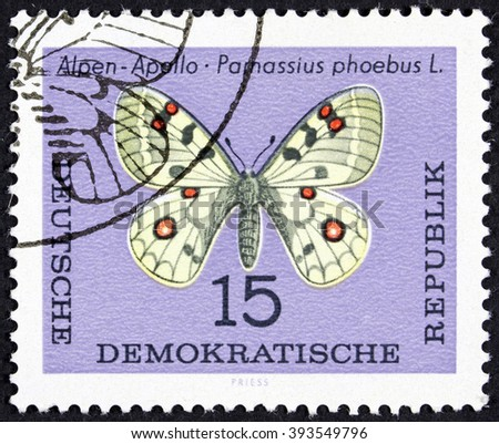 GROOTEBROEK ,THE NETHERLANDS - MARCH 15,2016 : A stamp printed in Fujeira shows a butterfly, circa 1967. - stock photo