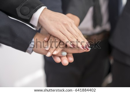 Group of business Asian people with hands together.Business concept.