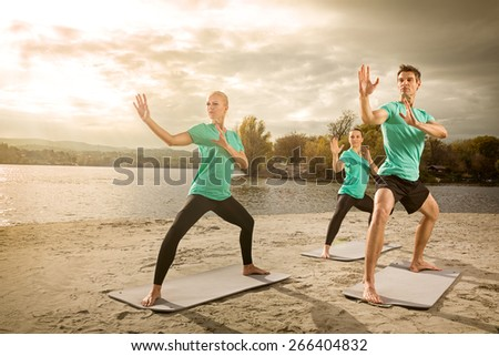 Group of young people practicing yoga - stock photo