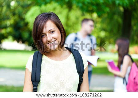 Group of young students outdoor - stock photo
