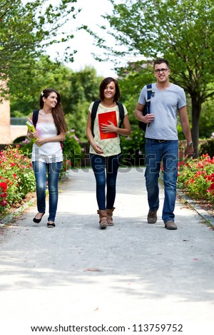 Group of young students walking outdoor - stock photo