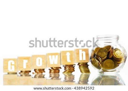 """""""Growth"""" text written on wooden block with increased stacked coins and full jar of coins on isolated white background - business and finance concept - stock photo"""