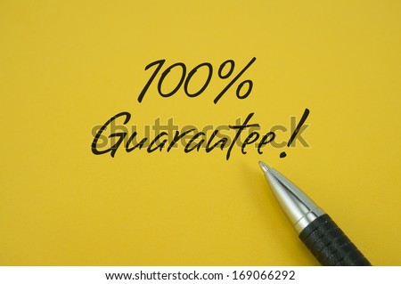 100% Guarantee note with pen on yellow background