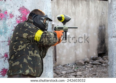 Guy with a paintball gun - stock photo