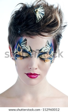 Halloween. Beautiful woman face with Creative Fashion Art make up and eyelashes