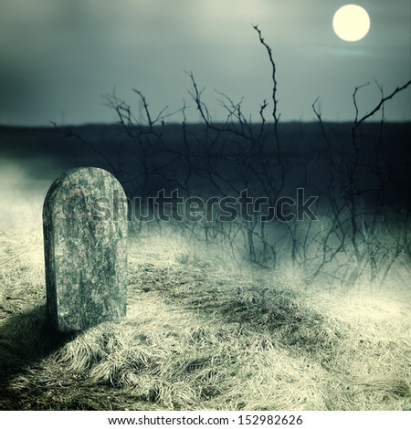Halloween concept. gravestone on old cemetery. Midnight with full moon - stock photo