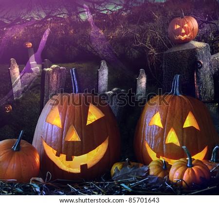 Halloween pumpkins in a grave yard - stock photo