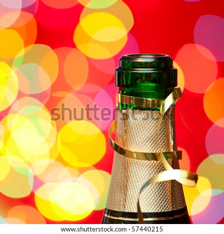?hampagne bottleneck with blured lights in background, very shallow DOF - stock photo