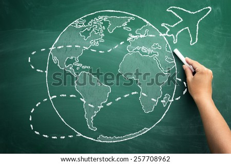 Hand drawing airplane travels around the world on a green blackboard, concept, traveling  - stock photo