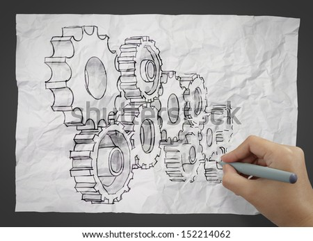 hand draws gear to success concept on crumpled paper as concept - stock photo