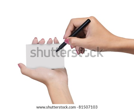 Hand female with pen writing on blank card