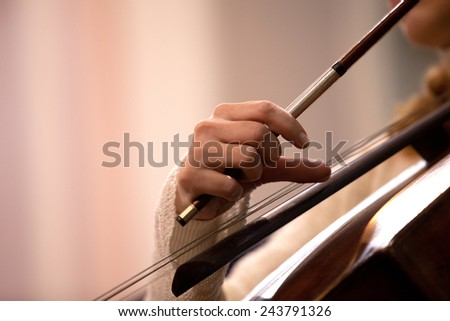 Hand girl playing cello