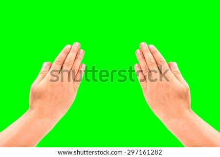 hand holding on green screen background - stock photo