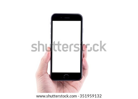 Hand holding the black smartphone with blank screen, isolated on white background. - stock photo