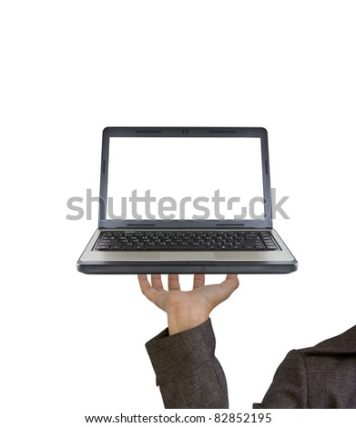 Hand holds the laptop on fingers as a tray