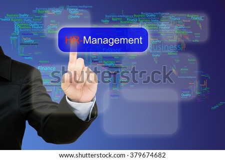 hand pressing Hr management button on interface with world map  background.