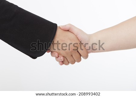 Hand shake of two business women