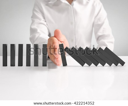 hand stop a dominoes continuous toppled  - stock photo