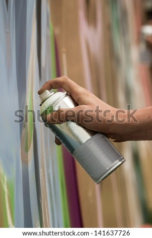 Hand with a paint a spray - stock photo