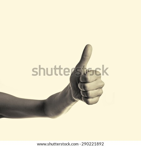 hand with a raised thumb up - stock photo
