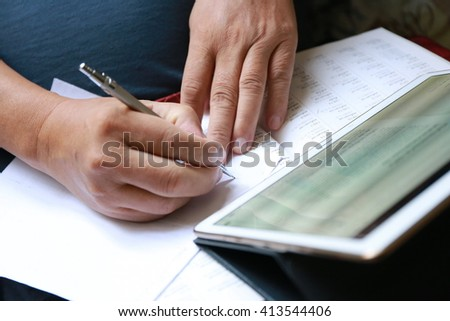 hand write pen on document paper with tablet ,using tablet, Internet of things lifestyle with wireless communication and internet with smart phone. - stock photo