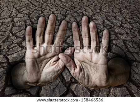 hands and dry earth - stock photo