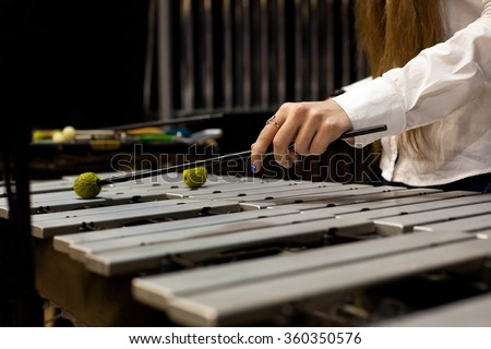 Hands girl playing the marimba - stock photo