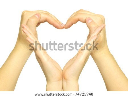 hands made in the form of heart - stock photo