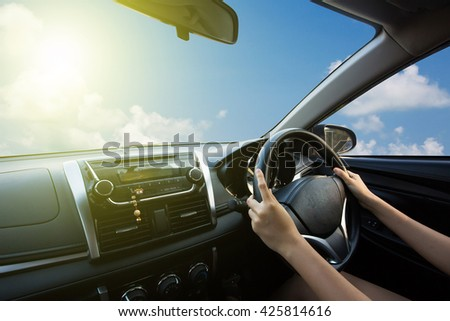 Hands of a driver on steering wheel of a car. drive to sky ,drive to the future