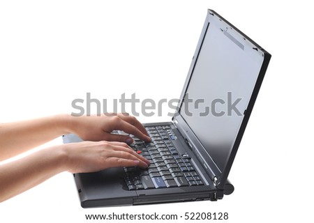 hands of woman typing on laptop keyboard