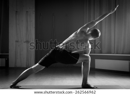 handsome man doing yoga  - stock photo