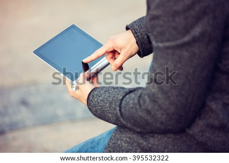 Handsome man using modern digital tablet. Toned photo - stock photo