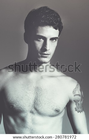 (handsome) muscular male model. Close up. Studio portrait - stock photo