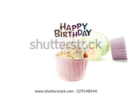 """Happy Birthday"" tag on chocolate chip ice-cream in a pink cupcake paper cup with white background. - stock photo"
