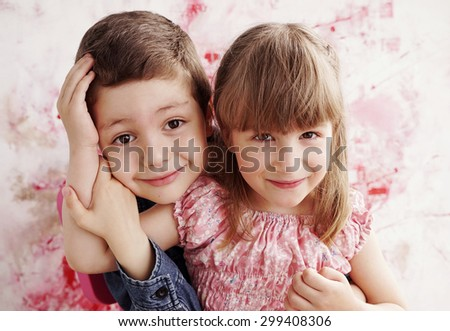 happy brother and sister hugging each other,love concept - stock photo