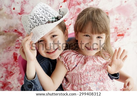 Happy brother and sister playing together               - stock photo