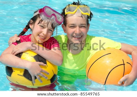 Happy children in pool - stock photo