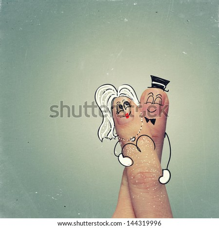 happy couple in love with painted smiley and hugging as vintage style - stock photo