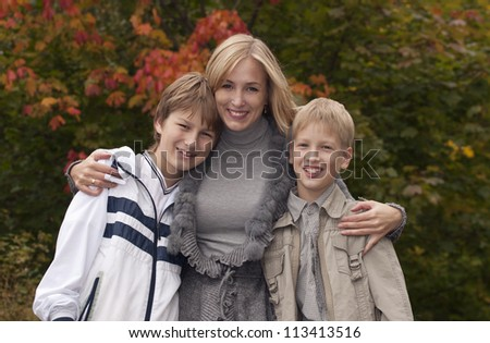 Happy family having fun in park - stock photo