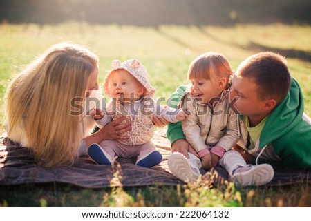 happy family in autumn park - stock photo