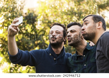 Happy Friends Taking Photo With Smart Phone - stock photo