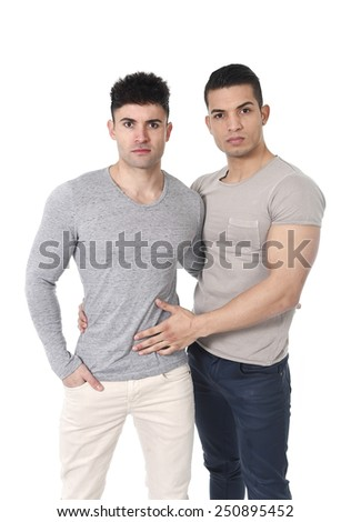 happy gay homosexual couple of young attractive and handsome men in love  wearing casual clothes with big strong bodies posing isolated on white   - stock photo