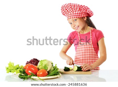 Happy little girl preparing fresh salad - stock photo