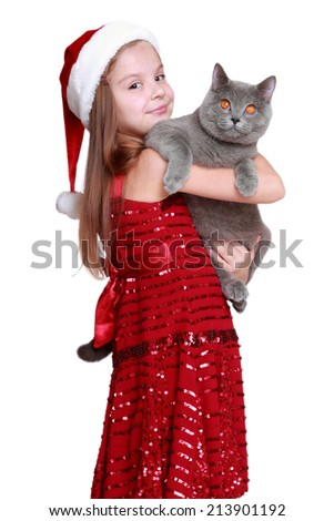 happy little girl with her new cat isolated - stock photo
