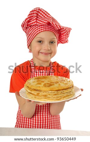 Happy little girl with pancakes - stock photo