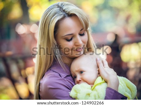 happy mother with baby in park